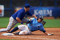 Charlotte Stone Crabs second baseman Kean Wong (4) slides in as third baseman Mitch Nay (28) waits for the throw during a game against the Dunedin Blue Jays on July 26, 2015 at Charlotte Sports Park in Port Charlotte, Florida.  Charlotte defeated Dunedin 2-1 in ten innings.  (Mike Janes/Four Seam Images)