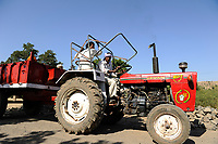 INDIA, Madhya Pradesh, Nimad region, Khargone , farmer with tractor