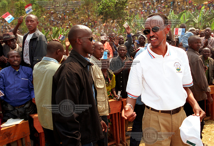 President Paul Kagame greets supporters at an election rally in Nyamutera, a small village 100km north of the capital Kigali. His party, the FPR, has ruled the country since the genocide in 1994. Kagame was re-elected with an overwhelming majority in August 2003.