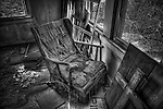 House interior with abandoned lounge chair Found in Vulture City Gold Mine in Arizona.