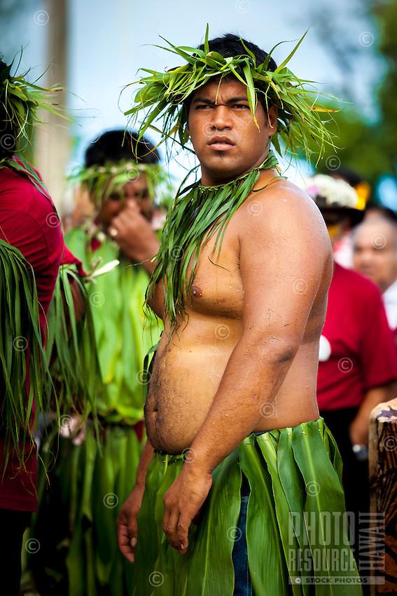 A man dressed in traditional Polynesian costume participates in a parade as part of the investiture of Makirau Haurua, Aitutaki Island, Cook Islands.