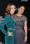 BEVERLY HILLS, CA- FEBRUARY 22: Actress Amy Adams (L) and guest arrive at the 16th Costume Designers Guild Awards at The Beverly Hilton Hotel on February 22, 2014 in Beverly Hills, California.