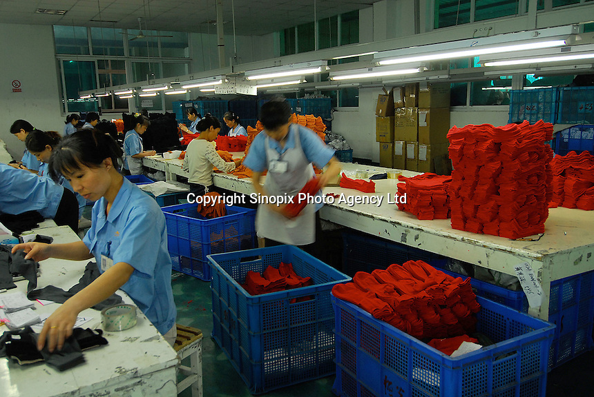 "Workers in a textile factory that produces socks in  Datang known as  ""Sock Town"" in Zhejiang Province, China. The town in Zhejiang Province makes more than 2.5 pairs for every human alive."