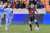 Houston, TX -  Friday, December 9, 2016: Charlie Furrer (20) of the Stanford Cardinal takes a shot at the North Carolina Tar Heels goal in the first half of the  NCAA Men's Soccer Semifinals at BBVA Compass Stadium.