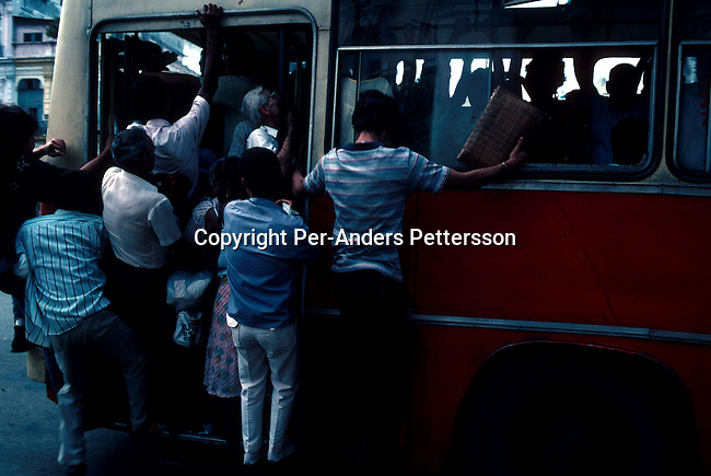 People trying to board a full buss on July 6, 1993 in central Havana, Cuba. The country have seen a severe drop in economic growth since the expiration of aid from the former Sovietunionen after the end of communism. Fidel Castro has ruled the communist island for over 4 decades and been in war of words with the United States all since then. They country has a good eduacation and medical level but lacks freedom of the press and speech. .(Photo: Per-Anders Pettersson/ Getty Images)