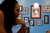 Jun. 10, 2013; Phoenix, AZ, USA: Detailed view of tattoo designs on the wall inside the Golden Rule Tattoo shop as Phoenix Mercury center Brittney Griner shops for a new tattoo. Mandatory Credit: Mark J. Rebilas-