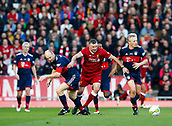 24th March 2018, Anfield, Liverpool, England; LFC Foundation Legends Charity Match 2018, Liverpool Legends versus FC Bayern Legends; John Aldridge of Liverpool Legends goes past the challenges of Marcel Witezcek and Hans Pflugler of Bayern Munich Legends