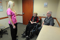 NWA Democrat-Gazette/FLIP PUTTHOFF<br /> Hanson chats with patient Sam Sinclair-Hall (cq) (center) and her husband, John Sinclair-Hall Thursday August 13 2015 at The Agility Center in Bentonville.