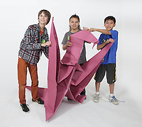 OrigamiUSA 2016 Convention at St. John's University, Queens, New York, USA. Oversized 9' x 9' paper folding event. First timers. Left to right: Spencer Linkous, VA, Erik Iancu, IL, unknown.