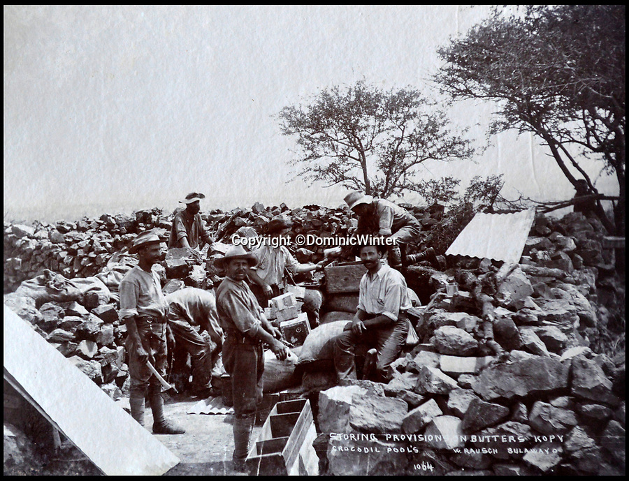 BNPS.co.uk (01202 558833)Pic: DominicWinter/BNPS<br /> <br /> Troops storing provisions - Bulawayo, Rhodesia (Zimbabwe) 1896 and 1900.<br /> <br /> These fascinating photos capture life in southern Africa at the end of the 20th century at a time of great uncertainty for the region.<br /> <br /> They were taken between 1896 and 1900 and cover the period of the Second Matabele War in Rhodesia, today known as Zimbabwe.<br /> <br /> One photo shows soldiers at a lookout with ammunition around their necks poised and ready to fire.<br /> <br /> Another image is of a laager, an encampment protected by a circle of wagons or armored vehicles.<br /> <br /> There is also the remarkable sight of troops lined up on bicycles and an imposing fort in the hills.