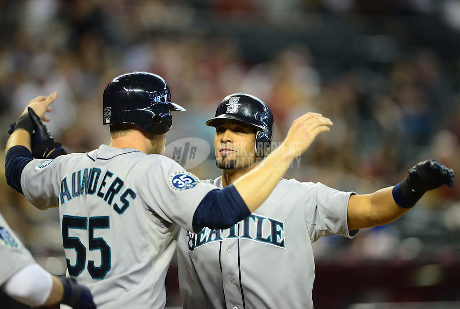 Jun. 20, 2012; Phoenix, AZ, USA; Seattle Mariners outfielder Franklin Gutierrez (right) is congratulated by teammate Michael Saunders after hitting a three run home run in the eighth inning against the Arizona Diamondbacks at Chase Field.  Mandatory Credit: Mark J. Rebilas-