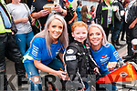 Poker Run : Pulmonary Fibrosis sufferer Michael Beazley, 8 years old,  pictured with Hanah McGrath and his mother Lisa Balmer prior to the start of the start of the poker to raise funds to buy lighter equipment for him to carry at Flannagan's Bar , Listowel on Sunday last.