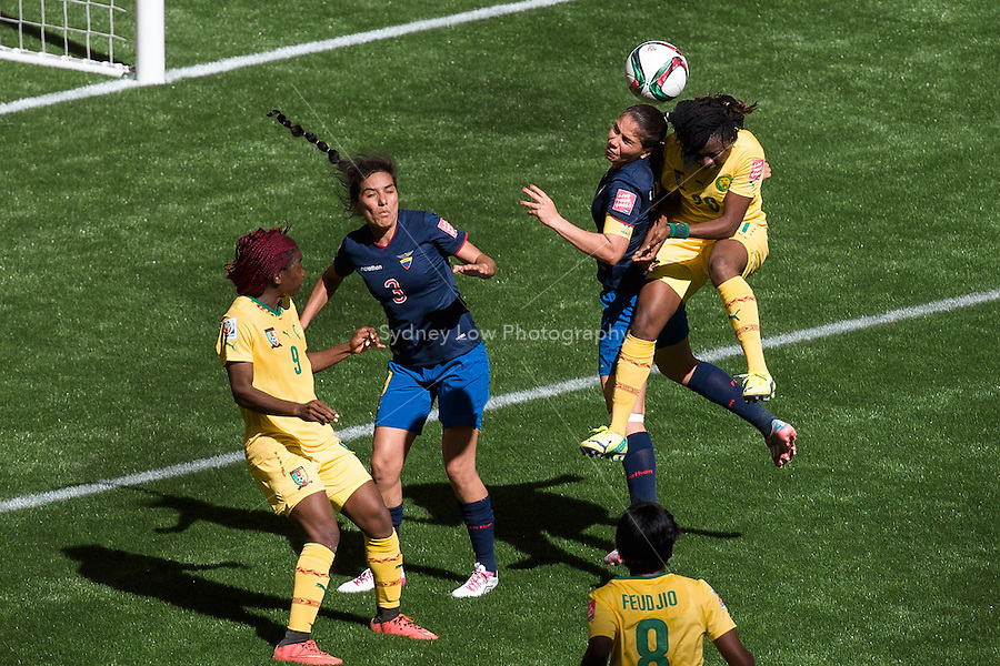 June 8, 2015: Genevieve NGO MBELECK of Cameroon jumps for the ball during a Group C match at the FIFA Women's World Cup Canada 2015 between Cameroon and Ecuador at BC Place Stadium on 8 June 2015 in Vancouver, Canada. Sydney Low/AsteriskImages
