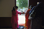 (L-r) Syeda Tasnim, 21, in pink, and Kanta Masud, 25, in orange, at to the Islamic Games in South Brunswick, New Jersey on May 26, 2007.  Tasnim and Masud are at the Islamic Games with their family to watch friends compete in the women's basketball tournament.