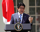Japan's Prime Minister Shinzo Abe participates in a joint news conference with US President Barack Obama at The White House in Washington DC for a State Visit, April 28, 2015. Credit: Chris Kleponis / CNP