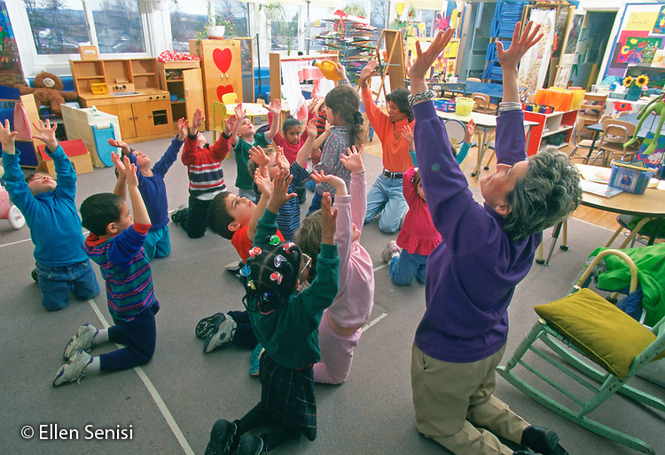 MR/ Schenectady, New York.Yates Arts-in-Education Magnet School / Pre-Kindergarten.Pre-Kindergarten teacher teaches dance movements for school program to students (age 4-5) and aide (African-American)..MR:YS-9-PK     FC#:23048-00317.scan from slide.© Ellen B. Senisi