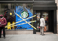 A Starbucks cafe on Fifth Avenue in New York sports a broken window on Friday, October 10, 2014. (© Richard B. Levine)