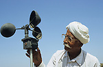INDIA Gujarat Bhavnagar, farmer measure wind speed / INDIEN Gujerat, Bauer an Windgeschwindigkeit Messgeraet