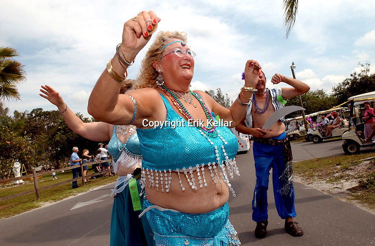 Thea Jurriaans, from Holland , belly dances with a group from her neighborhood during the Citrus Park Community Parade in Bonita Springs Tuesday. Erik Kellar