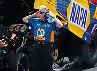 Jul 22, 2018; Morrison, CO, USA; Rahn Tobler, crew chief for NHRA funny car driver Ron Capps during the Mile High Nationals at Bandimere Speedway. Mandatory Credit: Mark J. Rebilas-USA TODAY Sports