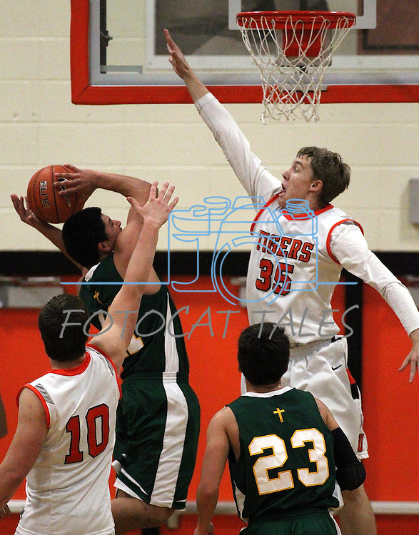 Douglas' Hunter Myers goes up for a block during a boys basketball game between Bishop Manogue and Douglas High in Minden, Nev., on Thursday, Dec. 22, 2011..Photo by Cathleen Allison