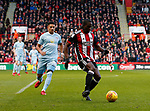 Clayton Donaldson of Sheffield Utd in action with Tyias Browning of Sunderland during the Championship match at Bramall Lane Stadium, Sheffield. Picture date 26th December 2017. Picture credit should read: Simon Bellis/Sportimage
