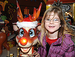 Jessica Leonard pictured with Rudolph at Santa's grotto at the Drogheda Town Centre. Photo: Colin Bell/pressphotos.ie