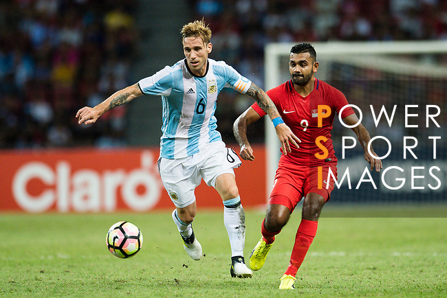 Lucas Biglia of Argentina (L) fights for the ball with Faritz Hameed of Singapore (R) during the International Test match between Argentina and Singapore at National Stadium on June 13, 2017 in Singapore. Photo by Marcio Rodrigo Machado / Power Sport Images
