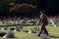 An army officer looks at the graves of military personnel who died in Japan during the war or occupation at Hodagya  Commonwealth War Graves cemetery on Remembrance Sunday in Hodogaya, Yokohama, Kanagawa, Japan. Sunday November 12th 2017. The Hodagaya Cemetery holds the remains of more than 1500 servicemen and women, from the Commonwealth but also from Holland and the United States, who died as prisoners of war or during the Allied occupation of Japan. Each year officials from the British and Commonwealth embassies, the British Legion and the British Chamber of Commerce honour the dead at a ceremony in this beautiful cemetery.