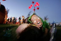 COACHELLA,CA - APRIL18,2009: Amit Chertof,right, enjoys the sunset with cousin Sarah Chertoff at Coachella Valley Music and Arts Festival Saturday, April 18, 2009. 147717.CA.0418.coachella