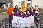Gaelscoil Faitleann in Killarney officially raised her  health flag at the school on Friday. .Front L-R Laura Ní Eílí, Emmet O'Croinín, Sinéad Ni Bhroin, Orianne McGuillicuddy, Kaydi Nic Gabhainn and Mark Ó Clúmhán. .Back L-R principal, Prionsais MacCurtain, HSE health promotion officer, Máire O'Leary, Austin Ó Coileáin and Seosamhin Ní Cheallaigh, Grace Ní Shuilleabhain, Lauren Nic Gearailt and health promotion co-ordinator Karen Úí Churtáin.