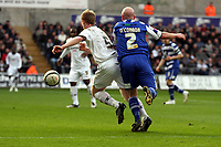 ATTENTION SPORTS PICTURE DESK<br /> Pictured: James O'Connor of Doncaster (R) commits a foul against Alan Tate of Swansea (L) which earned Swansea a penalty kick which was scored by jason Scotland (not pictured)<br /> Re: Coca Cola Championship, Swansea City FC v Doncaster Rovers at the Liberty Stadium. Swansea, south Wales, Saturday 21 February 2009<br /> Picture by D Legakis Photography / Athena Picture Agency, Swansea 07815441513