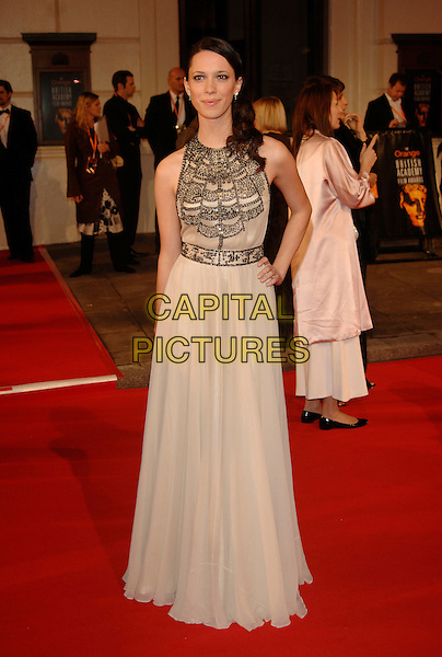 REBECCA HALL.Red Carpet Arrivals at The Orange British Academy Film Awards (BAFTA's) held at the Royal Opera House, Covent Garden, London, England, February 11th 2007..full length cream dress beaded.CAP/PL.©Phil Loftus/Capital Pictures