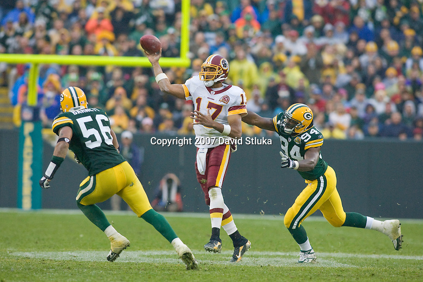 Quarterback Jason Campbell #17 of the Washington Redskins throws a pass during an NFL football game against the Green Bay Packers at Lambeau Field on October 14, 2007 in Green Bay, Wisconsin. The Packers beat the Redskins 17-14. (Photo by David Stluka)
