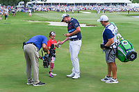 Marc Leishman (AUS) shakes hands with a young St. Jude patient near the green on 18 during round 4 of the WGC FedEx St. Jude Invitational, TPC Southwind, Memphis, Tennessee, USA. 7/28/2019.<br /> Picture Ken Murray / Golffile.ie<br /> <br /> All photo usage must carry mandatory copyright credit (© Golffile | Ken Murray)