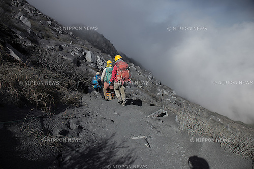 "EXCLUSIVE CONTENT: Mount Ontake, September 27, 2014 - Eyewitness images shot by a hiker trapped on the top of Mout Ontake, the Japanese volcano as it erupted on Saturday 27th September 2014. Huge plumes of smoke and ash spewing from the volcano and people sheltering in the pitch black inside a mountain top hut whilst rocks and ash rained down. The hiker was able to descend after a few hours through deep ash, and can be heard speaking to another hiker who said that he had been at the summit at the time of the eruption and suffered burns and had seen ""4 or 5 dead"".  The final death toll is still unconfirmed although over 30 people are known to have been killed as a result of the eruption which saw toxic plumes of smoke rising over 10km high. Mt. Ontake is a popular hiking destination and the eruption occurred on a busy weekend with many hikers visiting the area to see the autumn colours. The last time there was a major eruption at the volcano was in 1979 and this time there was little recognised prior warning that the mountain would erupt. (Photo by AFLO)"