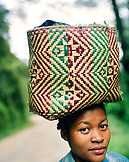 MADAGASCAR, mid adult woman carrying basket on head, Betsimisaraka Tribe