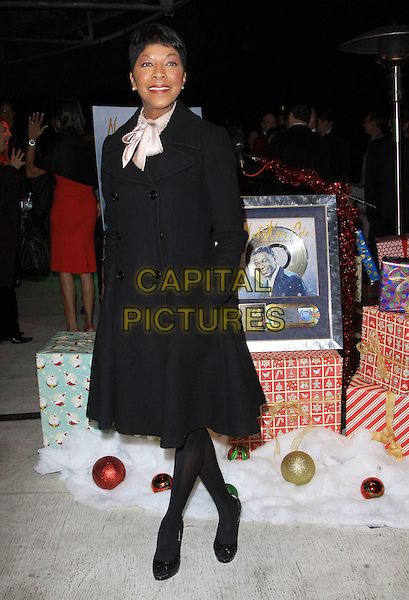 NATALIE COLE.Natalie Cole Lights Capitolís Legendary Rooftop Christmas Tree. Held At Capitol Records Rooftop, Hollywood, California, USA..November 19th, 2009.full length black gold silk satin scarf hands in pockets .CAP/ADM/KB.©Kevan Brooks/AdMedia/Capital Pictures.