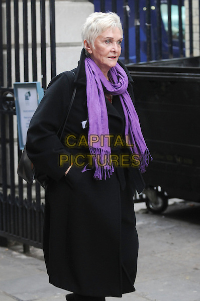 SHEILA HANCOCK  .At the Memorial service of Geoffrey Hutchings, St. Paul's Church, Bedford Street, London, England, UK, .February 18th 2011..half length black coat purple scarf hands in pockets .CAP/IA.©Ian Allis/Capital Pictures.
