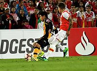 BOGOTA - COLOMBIA – 23 – 05 - 2017: Sebastian Salazar (Der.) jugador de Independiente Santa Fe, disputa el balón con Diego Wayar (Izq.) jugador de The Strongest, durante partido entre Independiente Santa Fe de Colombia y The Strongest de Bolivia, de la fase de grupos, grupo 2, fecha 6 por la Copa Conmebol Libertadores Bridgestone 2017, en el estadio Nemesio Camacho El Campin, de la ciudad de Bogota. / Sebastian Salazar (R) player of Independiente Santa Fe, fights for the ball with Diego Wayar (L) player of The Strongest during a match between Independiente Santa Fe of Colombia and The Strongest of Bolivia, of the group stage, group 2 of the date 6th, for the Conmebol Copa Libertadores Bridgestone 2017 at the Nemesio Camacho El Campin in Bogota city. VizzorImage / Luis Ramirez / Staff.