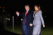 United States President Donald J. Trump waves to the presses he and first lady Melania Trump return to the White House in Washington, DC after a trip to London for the NATO summit on Wednesday, December 4, 2019.<br /> Credit: Erin Scott / Pool via CNP
