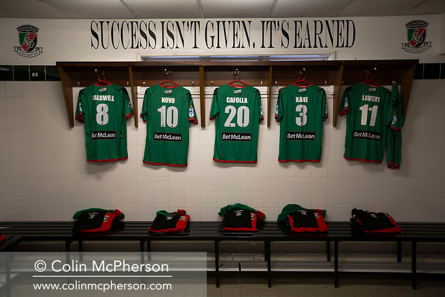 Shirts and slogans in the home dressing room at The Oval, Belfast, pictured before Glentoran hosted city-rivals Cliftonville in an NIFL Premiership match. Glentoran, formed in 1892, have been based at The Oval since their formation and are historically one of Northern Ireland's 'big two' football clubs. They had an unprecendentally bad start to the 2016-17 league campaign, but came from behind to win this fixture 2-1, watched by a crowd of 1872.