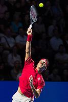 27th October 2019; St. Jakobshalle, Basel, Switzerland; ATP World Tour Tennis, Swiss Indoors Final; Roger Federer (SUI) serves the ball in the match against Alex de Minaur (AUS) - Editorial Use