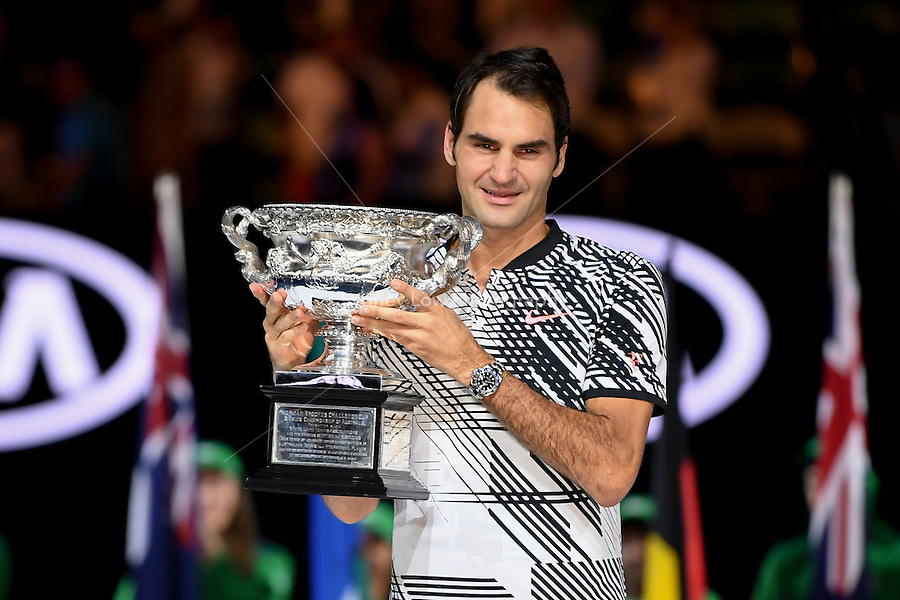 January 29, 2017: Roger Federer of Switzerland pose for photographs with the trophy after winning the Men's Final against Rafael Nadal of Spain on day 14 of the 2017 Australian Open Grand Slam tennis tournament in Melbourne, Australia. Photo Sydney Low