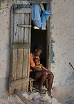 Meisier Genise sits in the doorway of he new home with her four-month old child in Picmy, a village on the Haitian island of La Gonave, one of many houses built by Service Chrétien d'Haïti for survivors of the 2016 Hurricane Matthew. SCH is a member of the ACT Alliance.