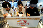 Three women design their own original cup noodle cips at the My Cup Noodle Factory inside the Momofuku Ando Instant Ramen Museum in Osaka, Japan on 20 October 2008. Visitors first design their cups before creating their own instant noodle concoction from ingredients on offer. .