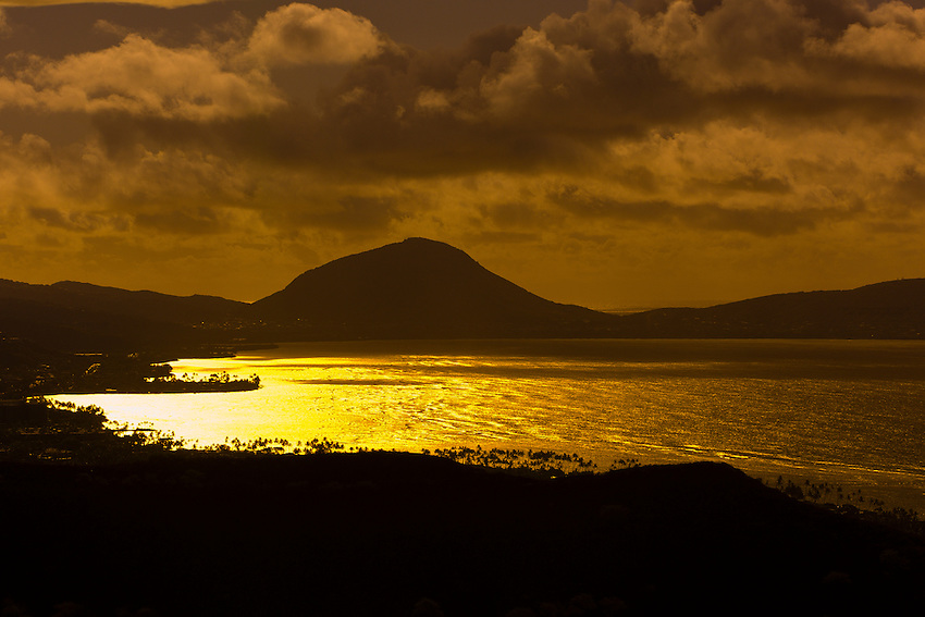 Golden light on Maunalua Bay with Koko Head Crater in background, near Honolulu, Oahu, Hawaii, USA