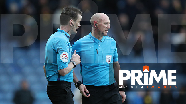 referee Andrew Davies speaks to his assistant Billy Smallwood and  overturns the late goal to give a decision Bradfords way to then speak to his other assistant James Mainwaring so then re give the goal during the Sky Bet League 1 match between Oxford United and Bradford City at the Kassam Stadium, Oxford, England on 16 March 2019. Photo by Thomas Gadd.