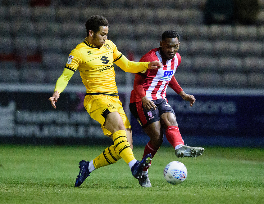 Lincoln City's Tayo Edun vies for possession with Milton Keynes Dons' Sam Nombe<br /> <br /> Photographer Andrew Vaughan/CameraSport<br /> <br /> The EFL Sky Bet League One - Lincoln City v Milton Keynes Dons - Tuesday 11th February 2020 - LNER Stadium - Lincoln<br /> <br /> World Copyright © 2020 CameraSport. All rights reserved. 43 Linden Ave. Countesthorpe. Leicester. England. LE8 5PG - Tel: +44 (0) 116 277 4147 - admin@camerasport.com - www.camerasport.com