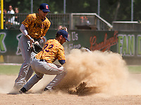 GREEN BAY - June 2015: Green Bay Bullfrogs outfielder Paul Jacobson (24) kicks up a pile of dust as he slides in to second base during a Northwoods League game against the Kenosha Kingfish on June 21st, 2015 at Joannes Park in Green Bay, Wisconsin. Green Bay defeated Kenosha 10-7. (Brad Krause/Krause Sports Photography)